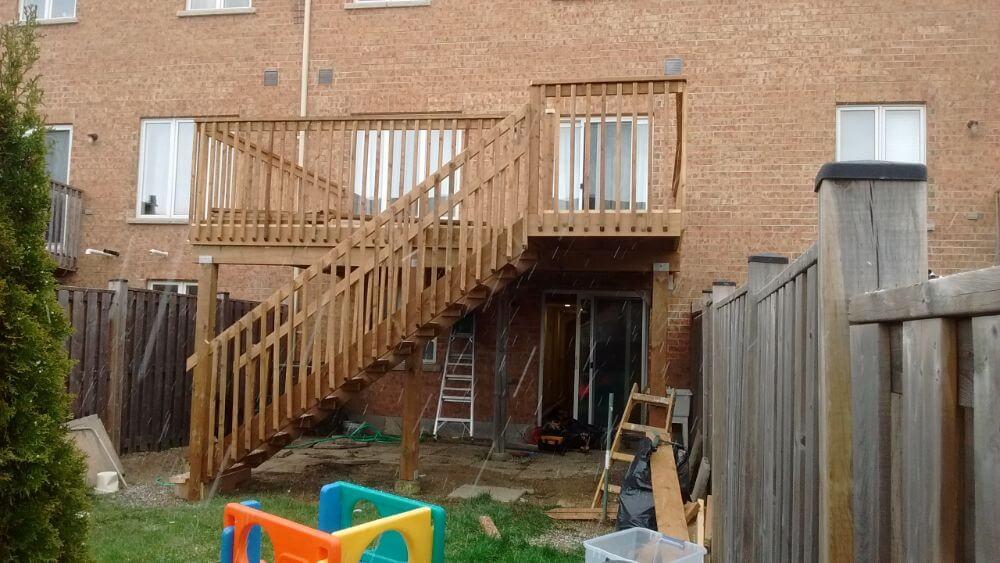2 story wooden deck in rain