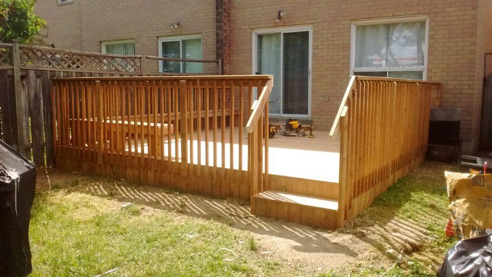 newly installed deck in small backyard