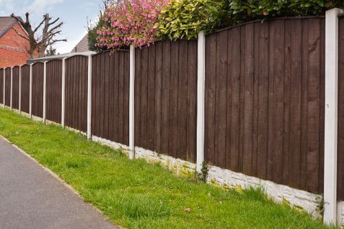 dark brown fence with white posts
