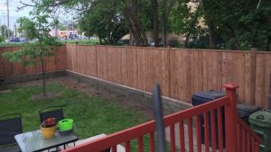 wooden fence along side a garden