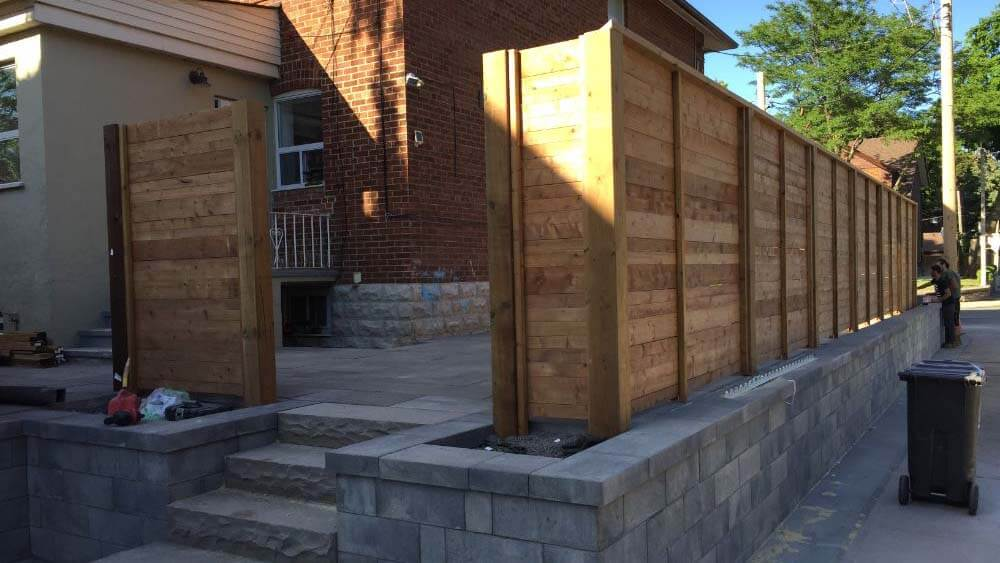 backyard fence and fence door being installed