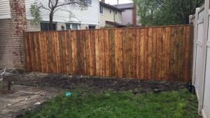 stained fence in between two residences